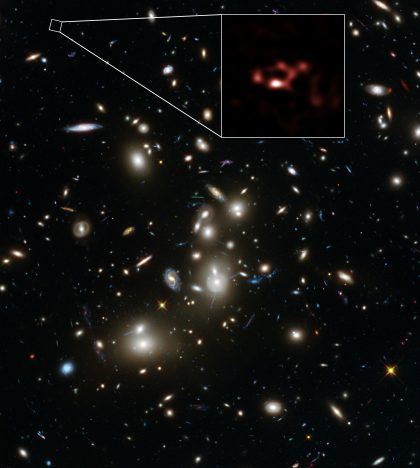 Dusty distant galaxy A2744_YD4 and galaxy cluster Abell 2744