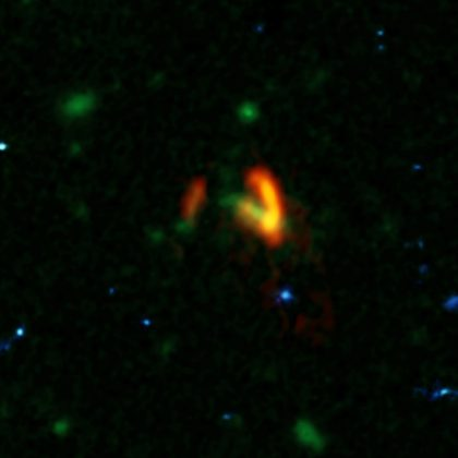 A composite image showing ALMA data (red) of the two galaxies of SPT0311-58